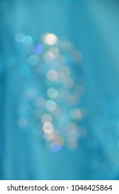 Glitter bokeh on turquoise