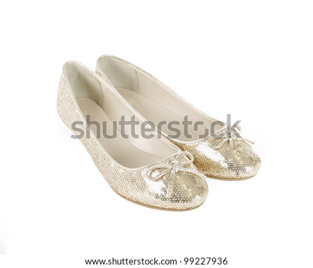 glitter gold flat shoes isolated on white