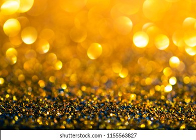 glitter gold lights grunge background, glitter defocused abstract Twinkly Lights Stars Christmas light Background.