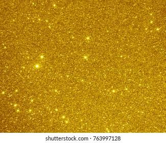 Glitter golden texture background. Christmas background light gold christmas