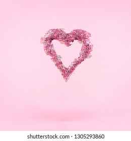 Glitter heart on pink background.  Valentines day and love concept. Square. Glitch effect, colorful disruptive