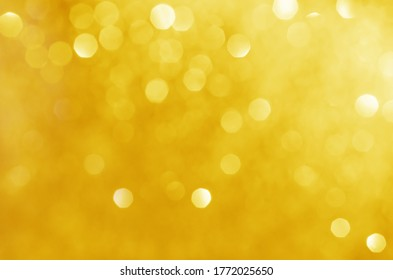 glitter light sparkle yellow golden gorgeous bokeh defocused abstract background shiny.
