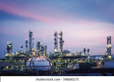 Glitter lighting of petrochemical plant with sky twilight, Manufacturing of petrochemical industrial, Oil and gas refinery plant at twilight