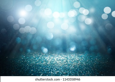 ฺblue glitter lights background. defocused