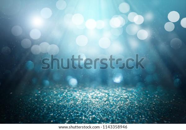 ฺblue glitter lights background. defocused