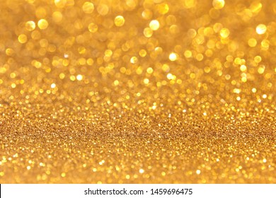 Glitter luxury gold shiny blurred background. Abstract  wallpaper Christmas valentine and new years gift.