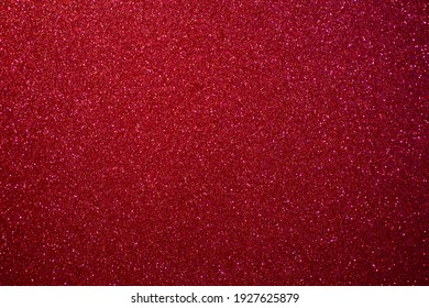 Glitter pink background.  Red and pink background with sparkling festive glitter.