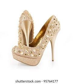 glitter spiked gold shoes isolated on white