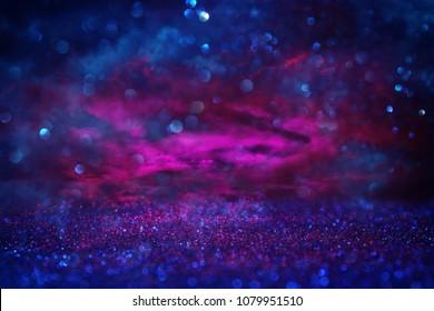 glitter vintage lights background. black , blue and purple. de-focused