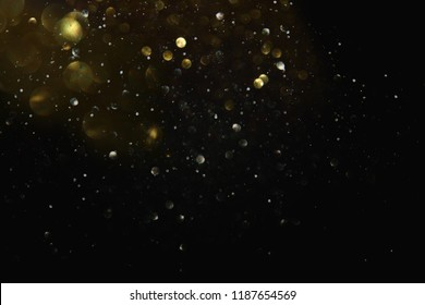 glitter vintage lights background. black and gold. de-focused