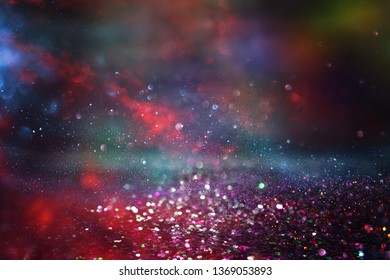 glitter vintage lights background. black and red. de-focused.
