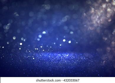 glitter vintage lights background. black, silver and blue. defocused