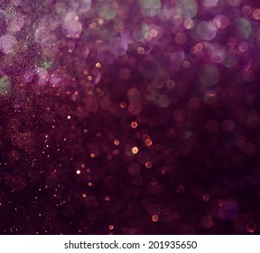 glitter vintage lights background. blue and purple. defocused