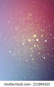 glitter vintage lights background. blue and purple. defocused