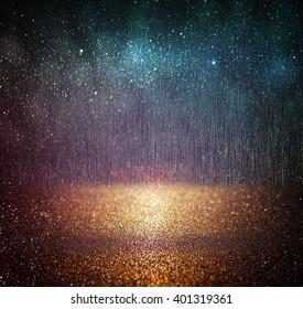 glitter vintage lights background. blue, gold and black. defocused.
