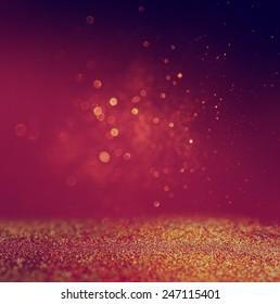 glitter vintage lights background. gold, red and purple. defocused