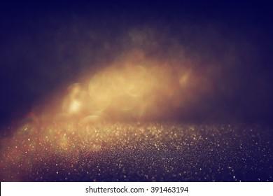 glitter vintage lights background. gold and black. defocused.