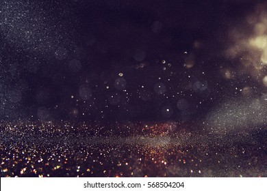 glitter vintage lights background. gold and black. de-focused - Shutterstock ID 568504204