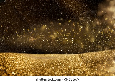 glitter vintage lights background. gold and black. de focused.