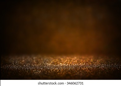 glitter vintage lights background. light silver, gold, black. defocused.