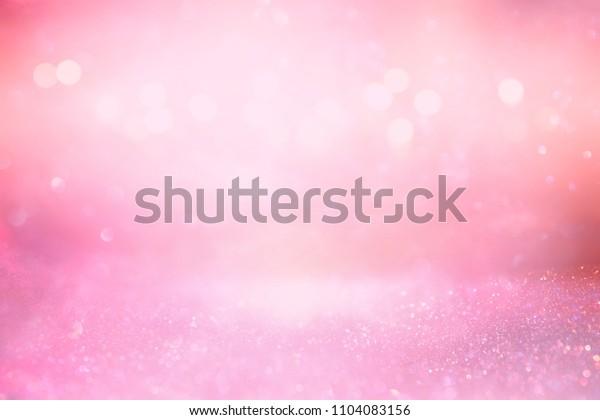 glitter vintage lights background. pink and silver. de-focused