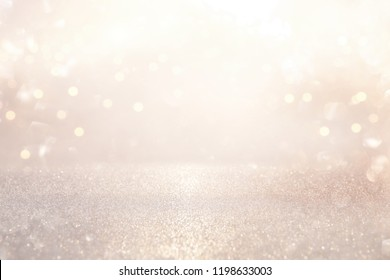 glitter vintage lights background. silver and light gold de-focused