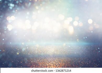 glitter vintage lights background. silver and blue. de-focused.