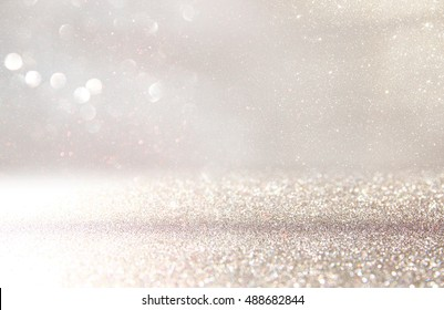 glitter vintage lights background. silver and white. de-focused