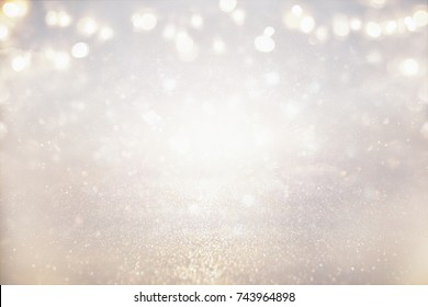 glitter vintage lights background. silver and light gold. de-focused.