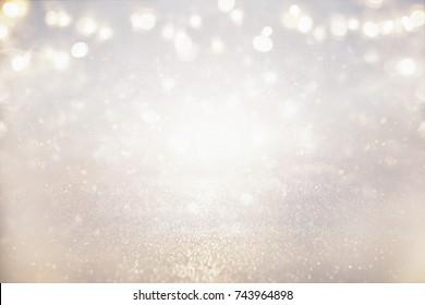 glitter vintage lights background. silver and light gold. de-focused.