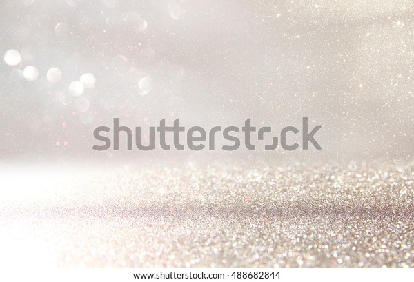 glitter vintage lights background. silver and white. de-focused