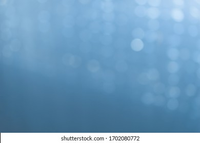 Glittering background with real bokeh of light blue color