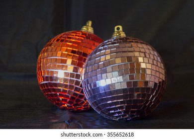 Glittering Christmas balls against a black background
