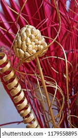 Glittering Christmas decoration: golden pinecone and red leaves.
