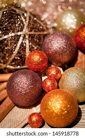 glittering christmas decoration in orange and brown natural wood closeup macro