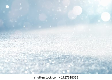 GLITTERING ICE WITH BOKEH LIGHTS, CHRISTMAS BACKDROP WITH BLANK SPACE FOR DISPLAY CHRISTMAS PRESENTS OR WINTER FRESH PRODUCTS