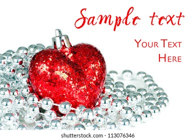 Glittering read heart with silver decorative beads isolated on white background