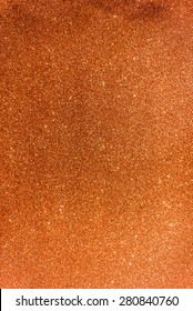 Glittery and Textured Orange Paper, out of focus
