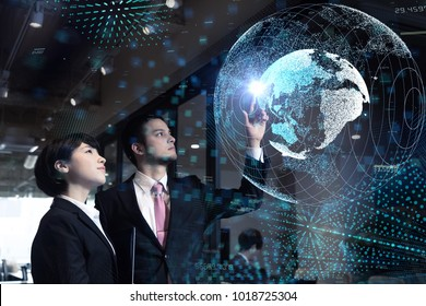 Global business concept. Young business persons watching GUI of world map.