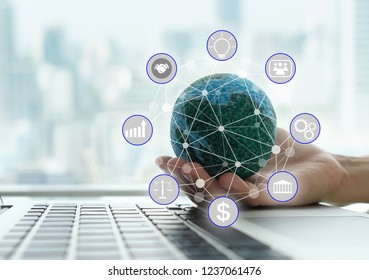 global business connection concept. global on computer with business icons and city background.