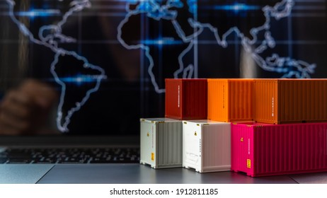 Global business container cargo ship in import export business logistic, Company shipping delivery and logistics technology business industrial, Container on computer laptop notebook selective focus. - Shutterstock ID 1912811185
