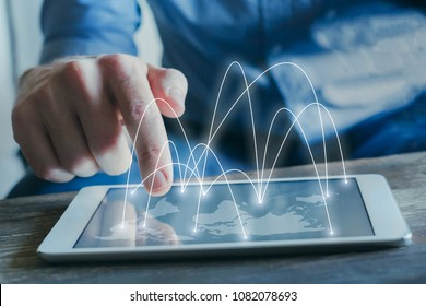 global business network and communication concept with businessman working on tablet screen with world map and international connections