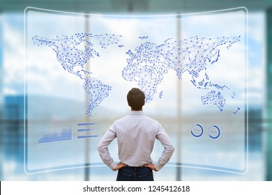 Global business network with connected lines on world map, worldwide data telecommunication for internet of things, fintech, and blockchain technology, concept with businessman analyzing dashboard