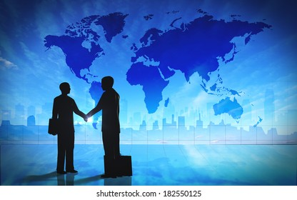 Global  Business shake hand silhouettes