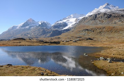 The global climate change is melting the permafrost and glaciers in the swiss alps like here at Lago Bianco on Bernina Hospitz