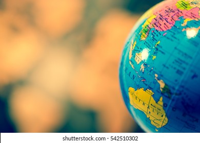 Global concept.  Blue Globe Against Blurred World Map.