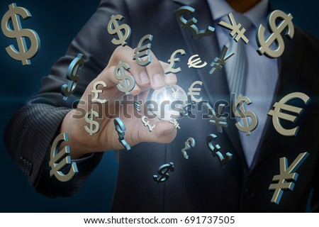 The global currency market. Businessman holding a globe against the background of the symbols of money.