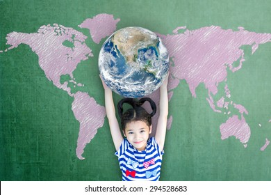 Global education and world literacy day concept with Asian girl kid student raising earth on chalkboard. Elements of this image furnished by NASA