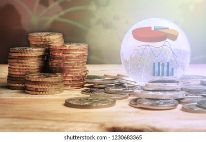 GLOBAL FINANCIAL  CONCEPT. Stack of coins and globe with graph icons over a blur map background. Selective focus