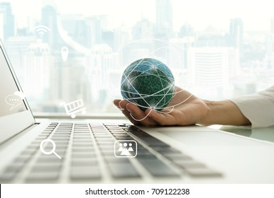 global internet of things concept. globe on hand of human and laptop computer with internet icon.